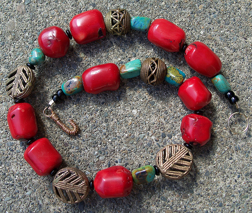 African-inspired necklace  by Judy Merrill-Smith featuring hand-cut coral beads similar to Ivie.